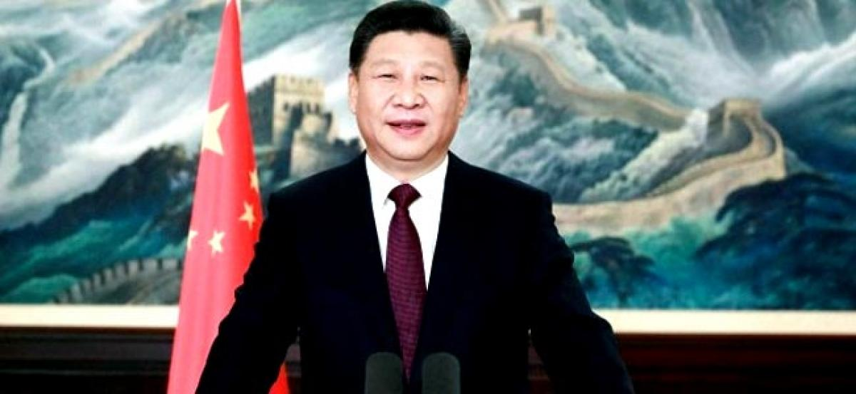 Chinas Xi Jinping says wont let anyone make fuss about its territory