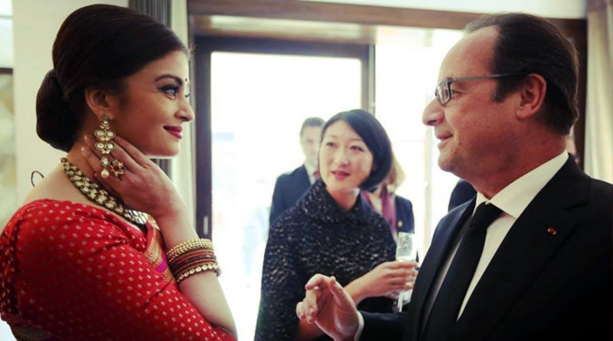 What did Aishwarya Rai Bachchan discuss with French President Hollande