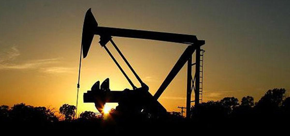 Oil prices drop on stronger US dollar