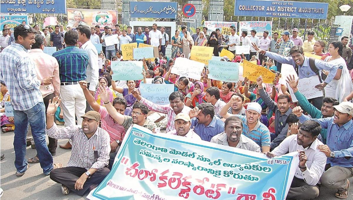 Model School teachers stage massive dharna at Collectorate