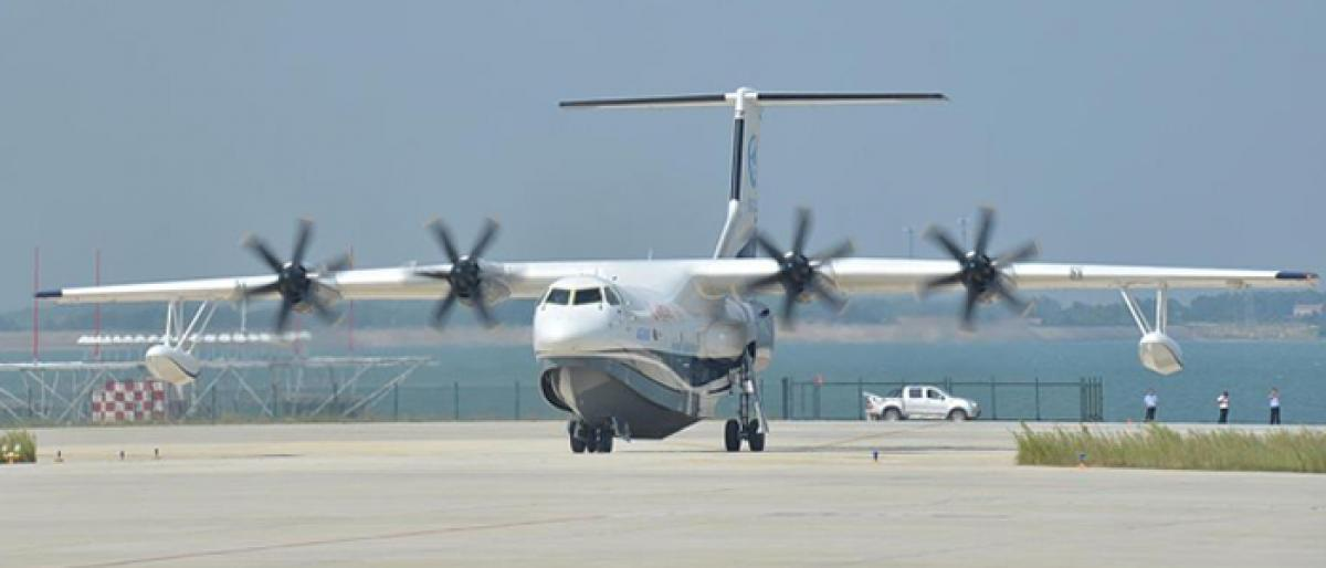 Chinese-made worlds largest amphibious aircraft completes successful flight