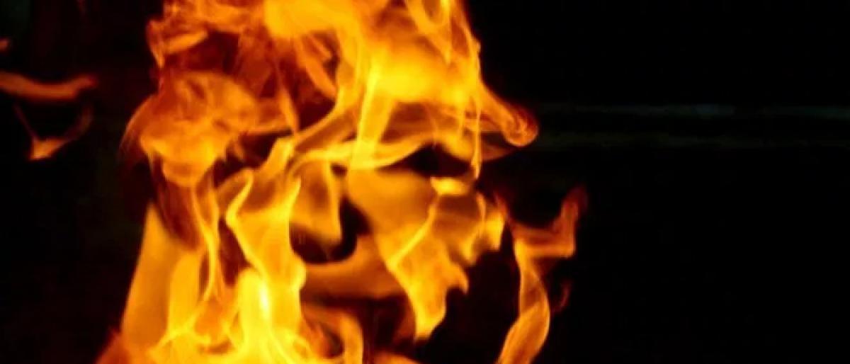 Woman 'torches self, probe underway