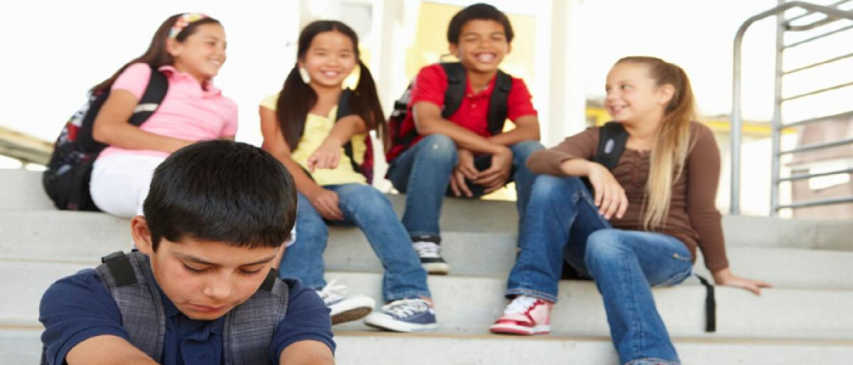 Kids point at adults for bullying