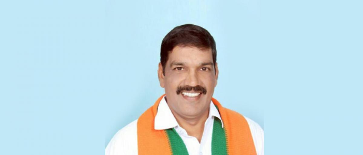 Srinivas BJP Kakinada city unit president