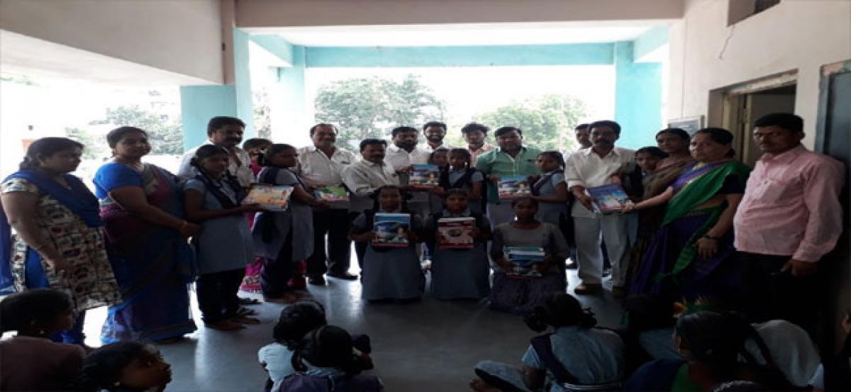 Golluri distributes text books to students