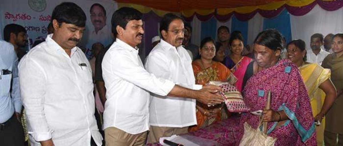 Minister Tummala distributes Bathukamma sarees in Khammam