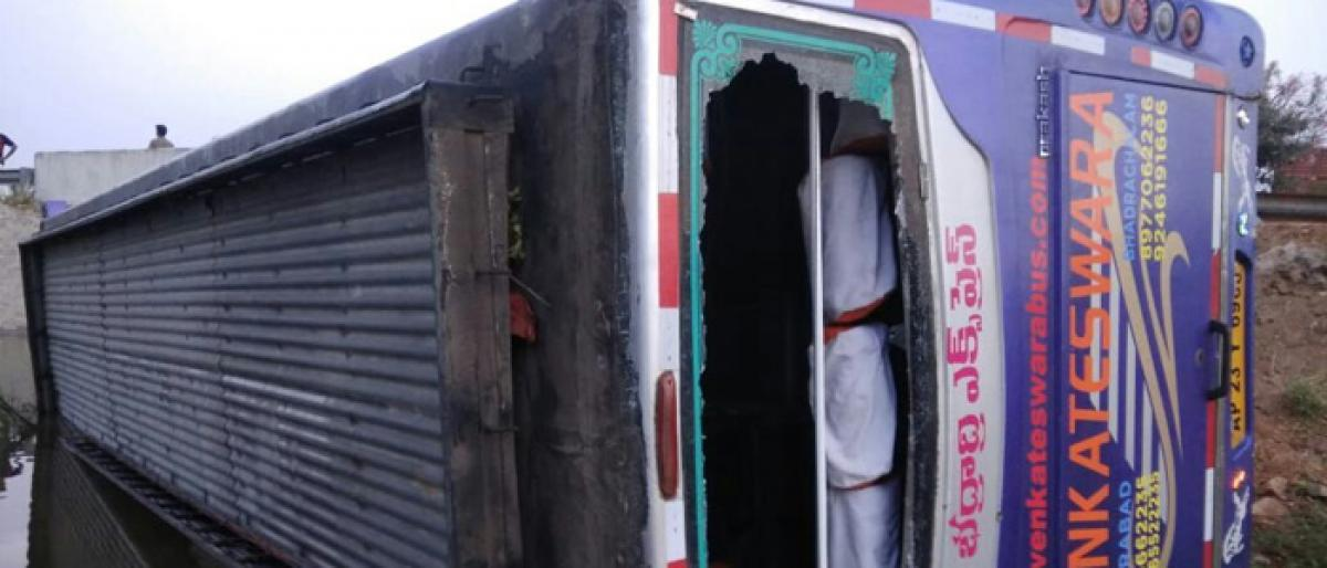 20 passengers injured as bus falls into feeder channel