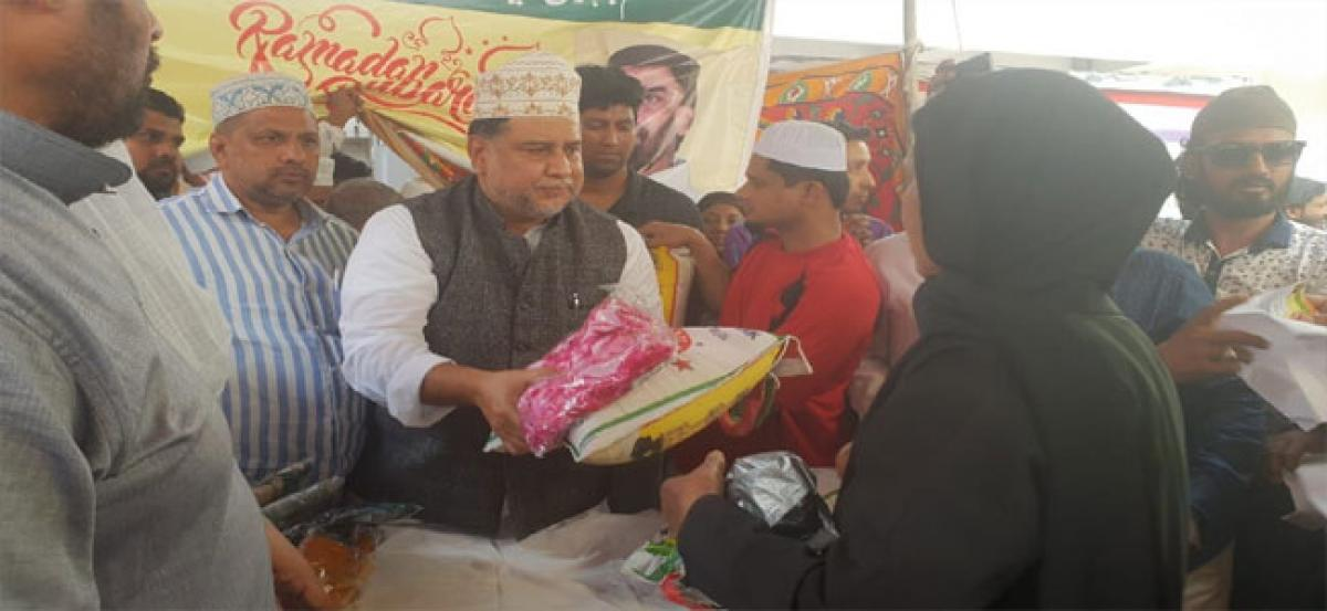 Masqati brothers distribute ration to 700 families