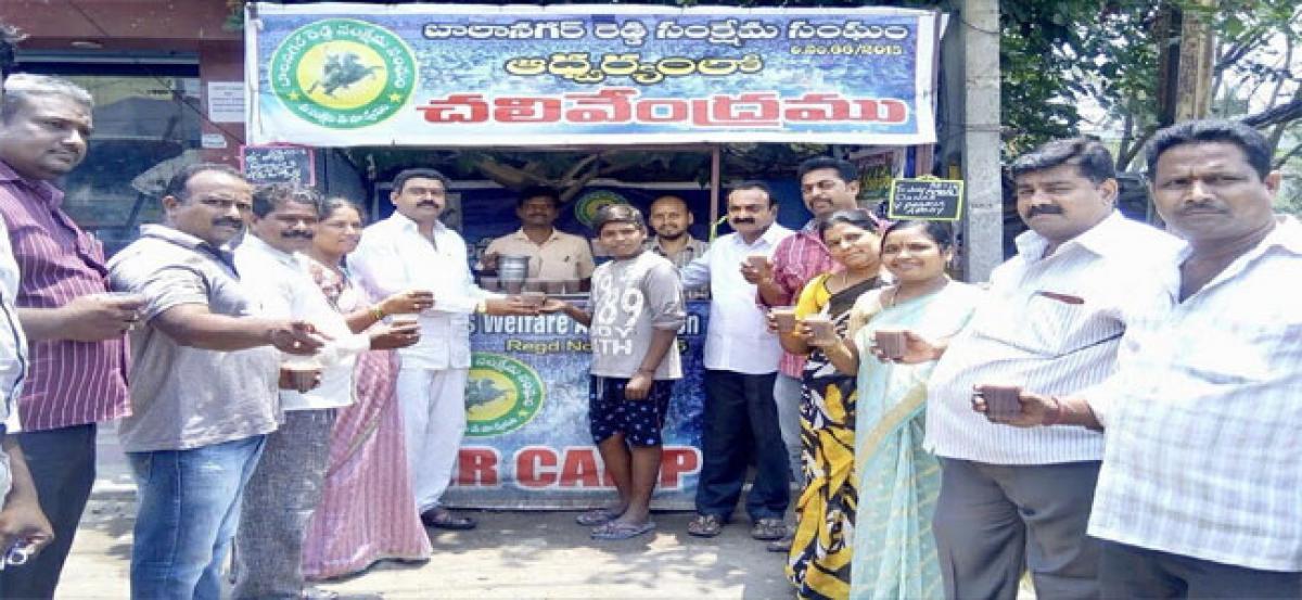 Corporator distributes Ragi gruel at water kiosk