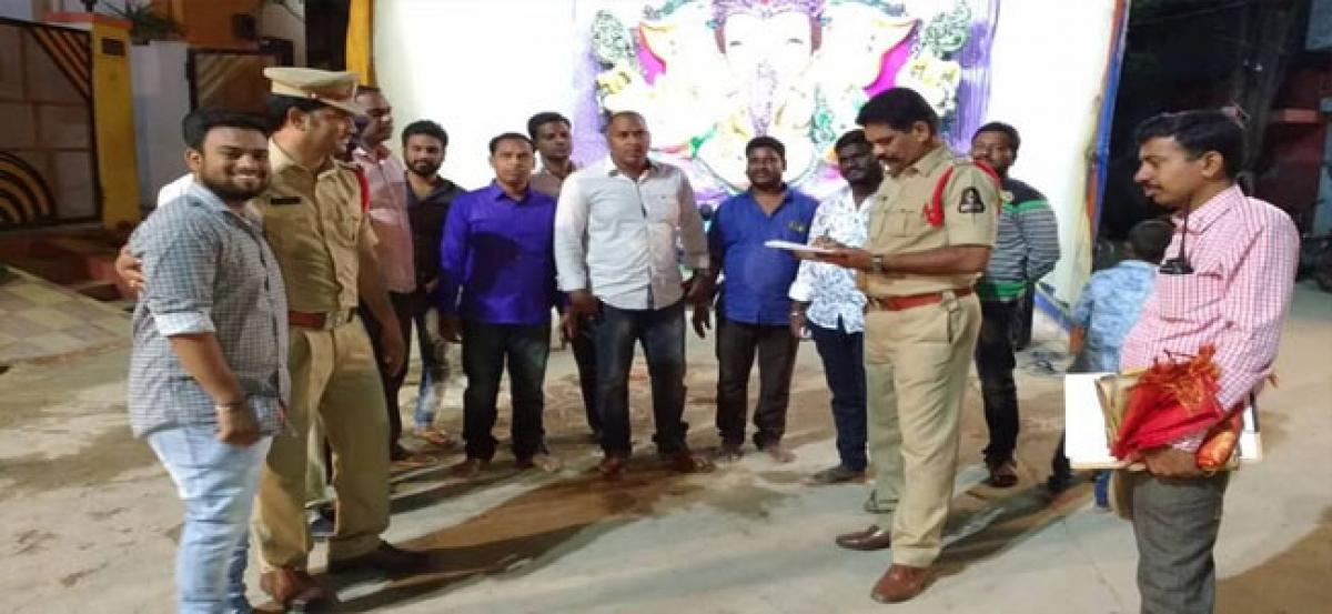 Police inspect Ganesh pandals