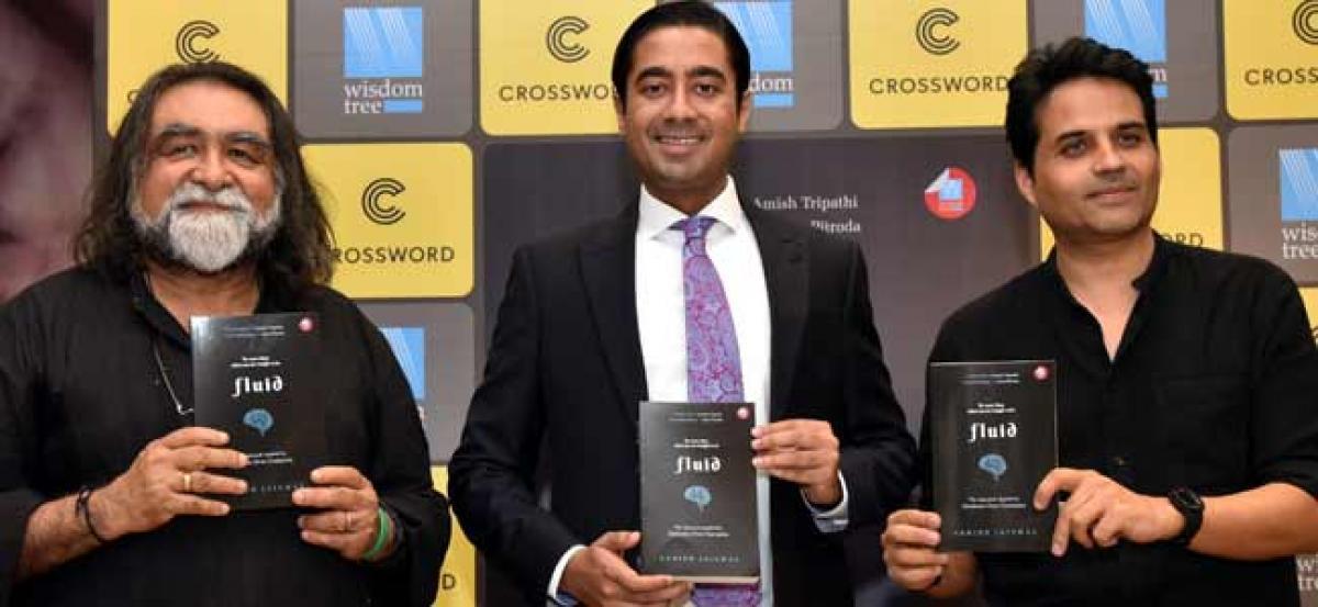 Prahlad Kakar and Raghav Podar launch Oxford scholar Ashish Jaiswal's book  'fluid' at Crossword Bookstores