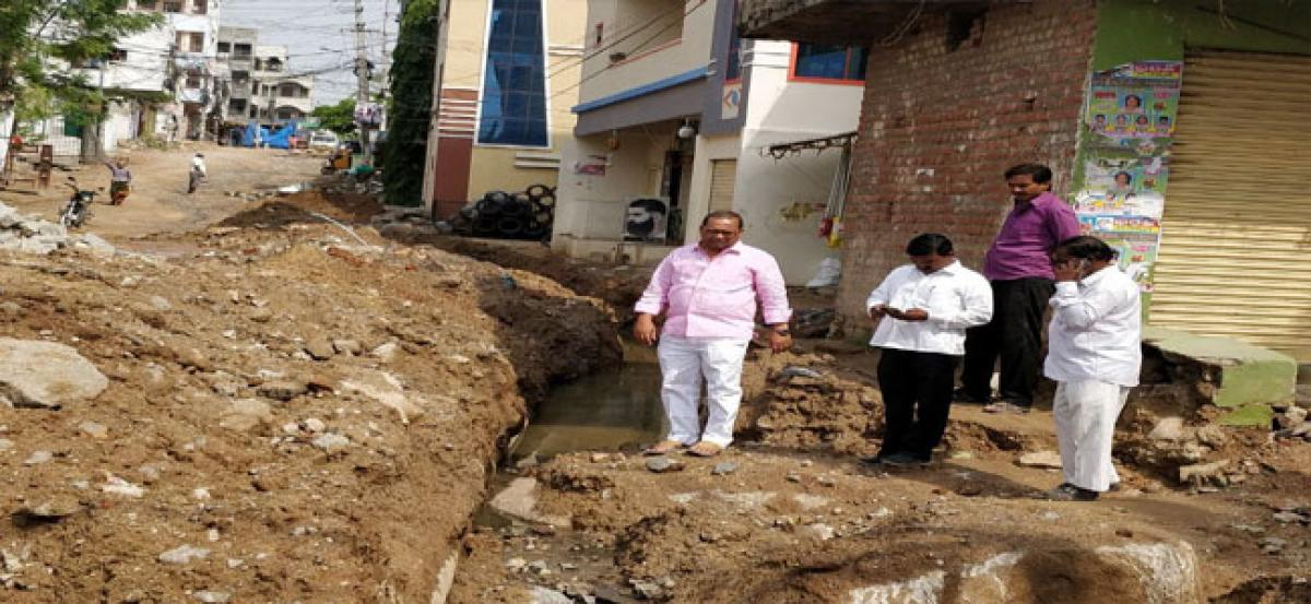 Corporator inspects incomplete drainage works