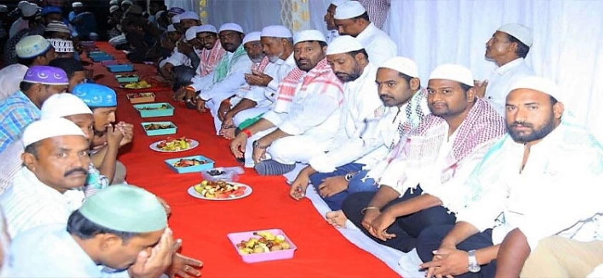 Former MLA Kuna Srisailam Goud takes part in Iftar
