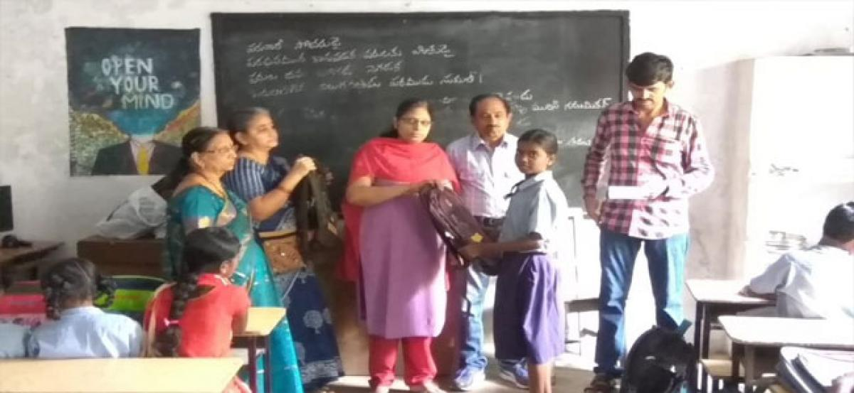 FOH hands over school bags to students