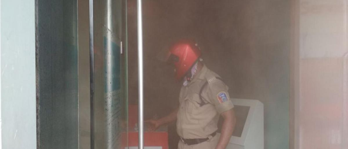 Fire accident at Vodafone store in Warangal