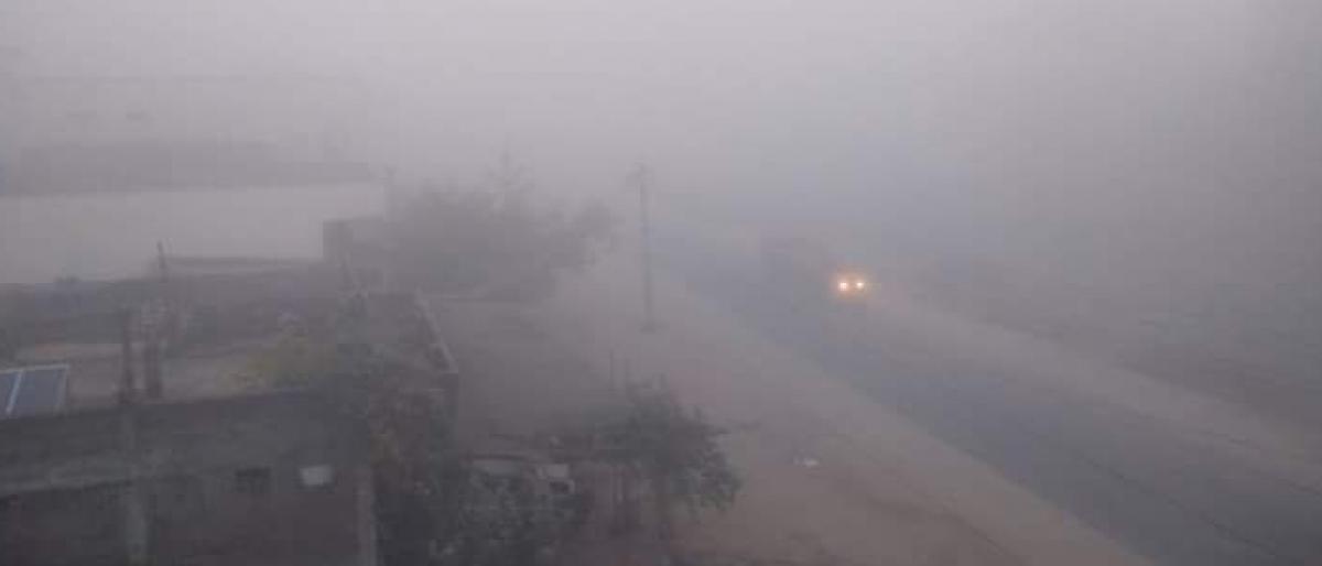 Thick fog envelopes villages