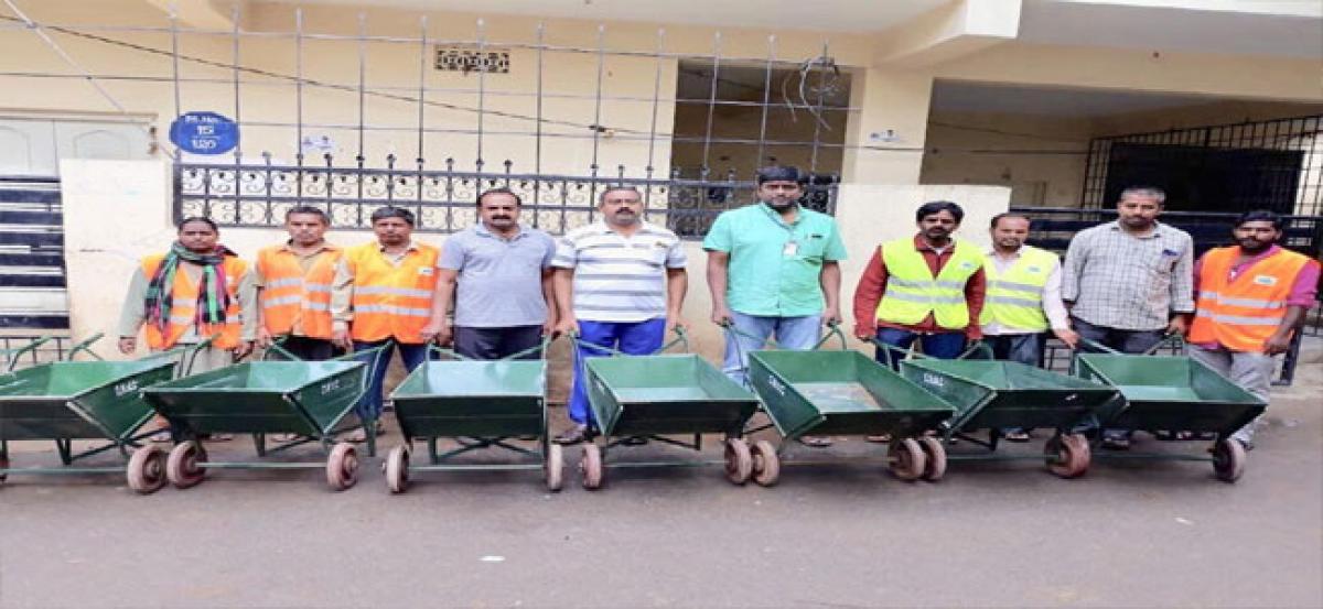 Garbage carts distributed
