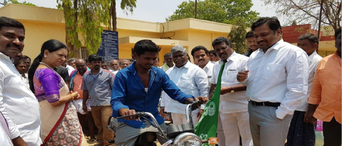 TVS mopeds distributed to fisherman community in Gadwal