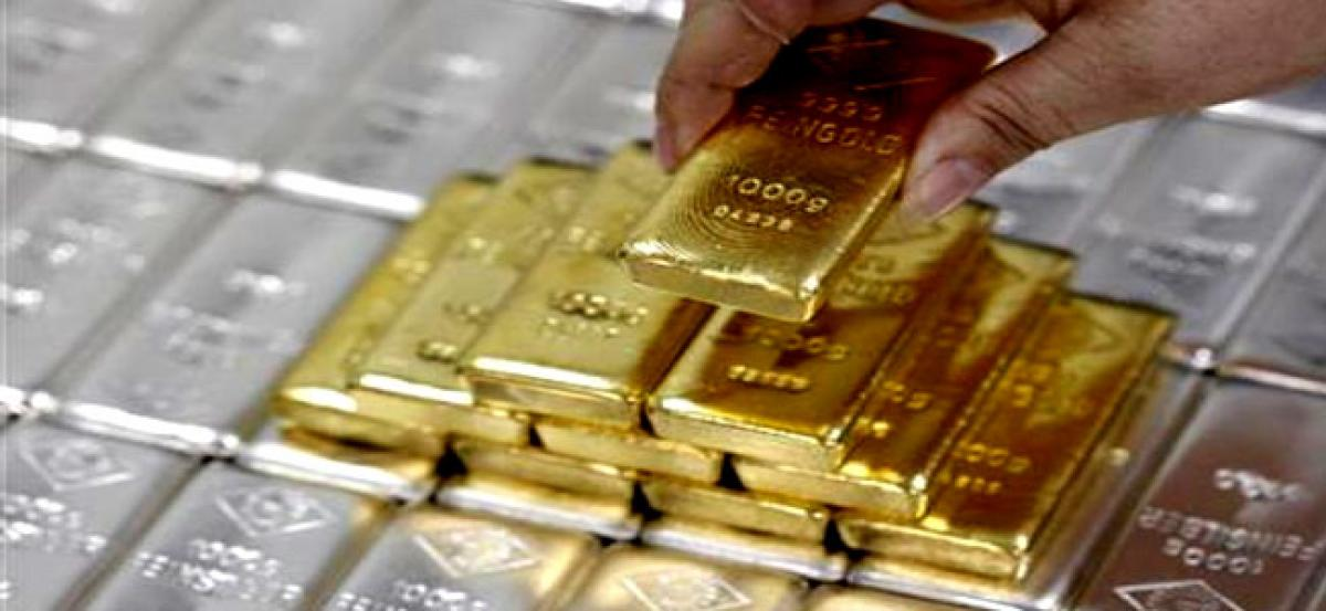 Gold firms up on global cues, silver slips