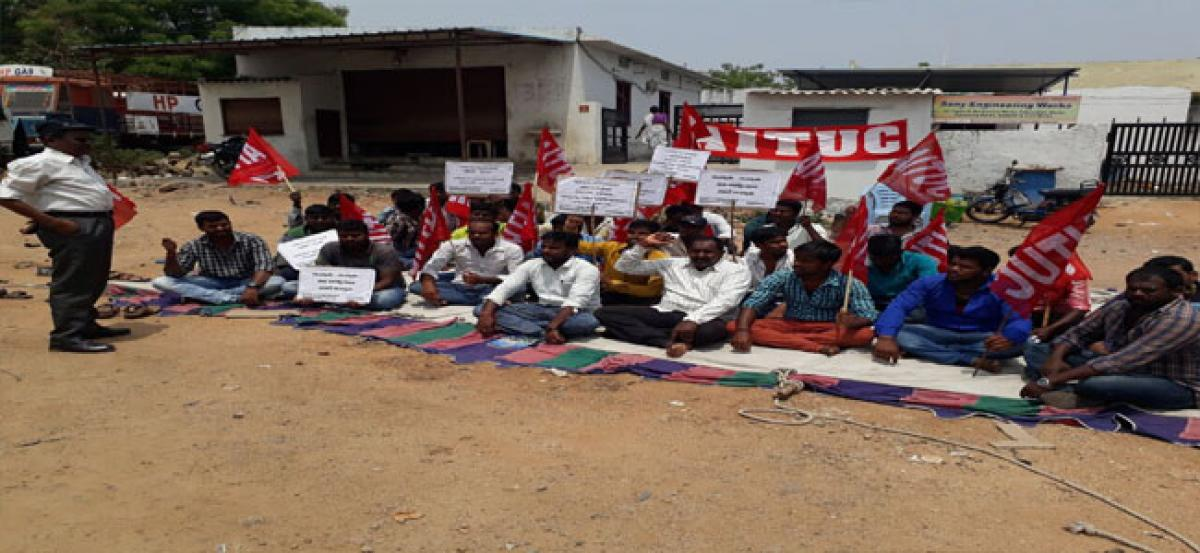 HP gas bottling plant contract workers stage dharna