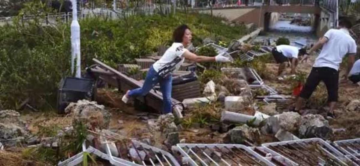 Hong Kong begins massive clean-up after Typhoon Mangkhut chaos