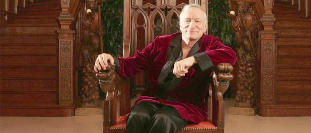 Hefners jacket, iconic black silk pajamas to be auctioned off