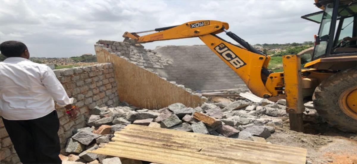 Revenue officials demolish illegal constructions