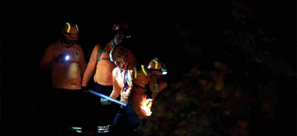 Thai cave rescue doctor emerges from rescue operations to family tragedy