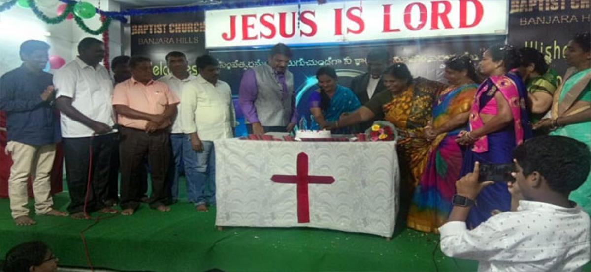 Kavitha offers prayers at Baptist Church
