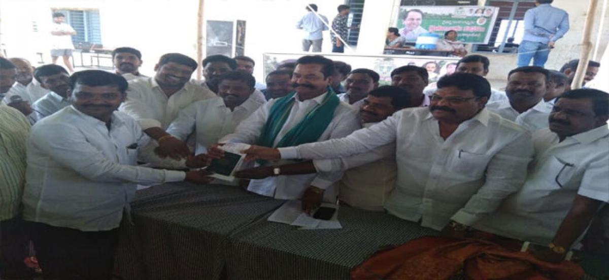 Cheques distributed to 145 farmers