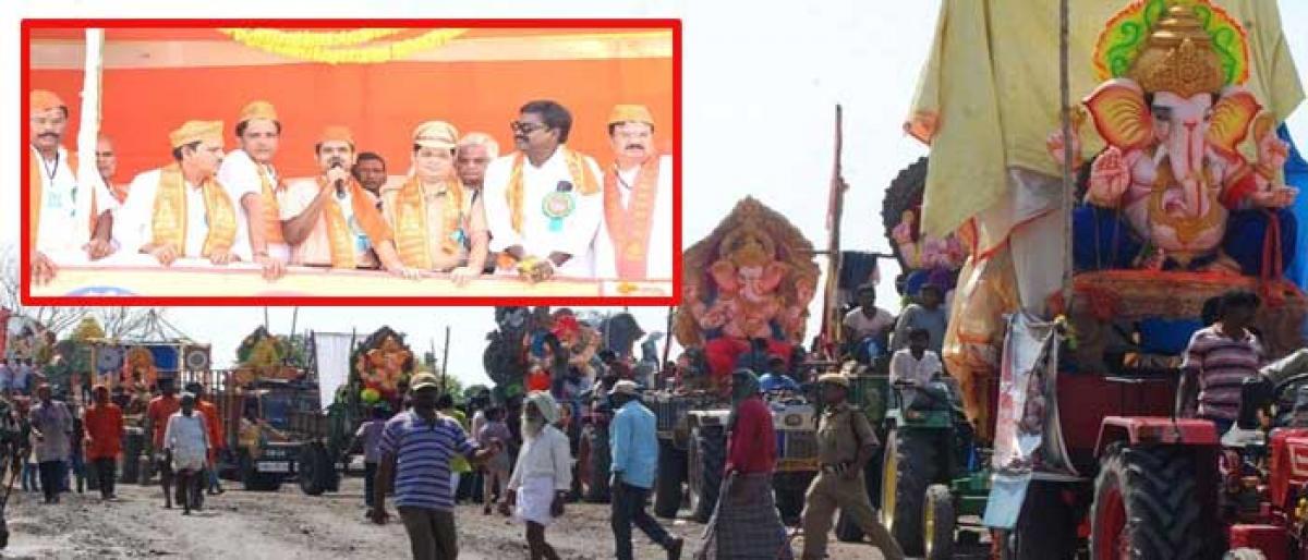 Devotees bid grand adieu to Lord Ganesha in Khammam