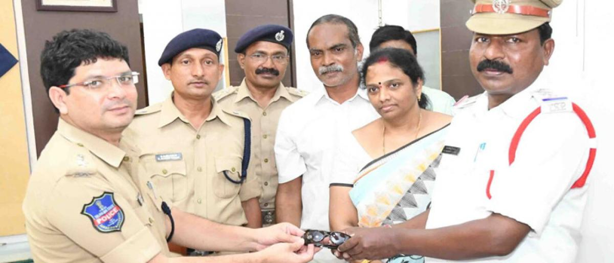 Sunglasses provided to Traffic cops in Khammam