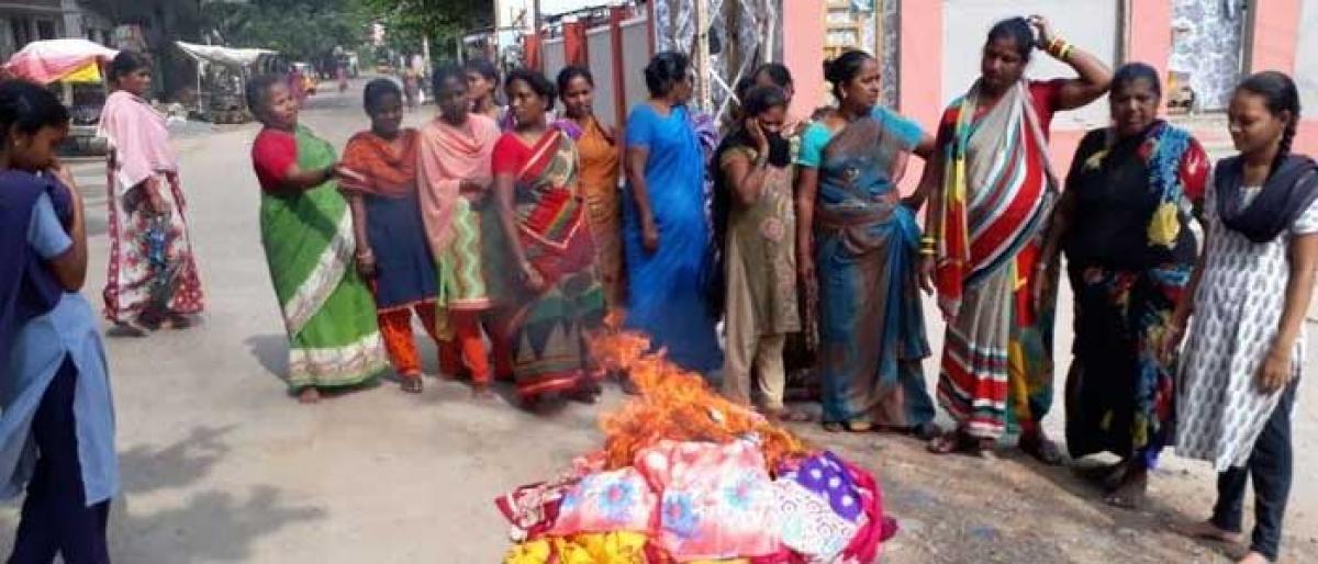 Women feel insulted, set Bathukamma sarees on fire