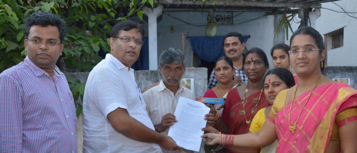 House site documents handed over to beneficiaries