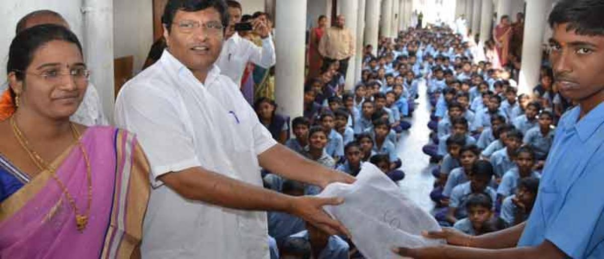 MLA distributes shoes to students