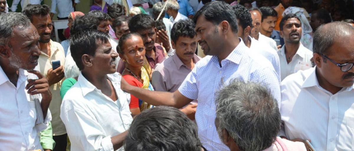 Mahbubnagar Collector visits cheque distribution centres