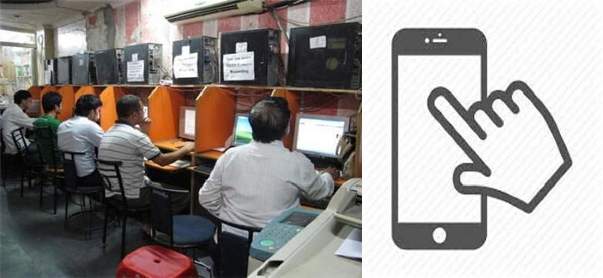 Smartphones ring death knell of cyber cafés