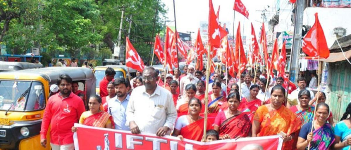 May Day fete held on grand scale, unions flay anti-labour policies