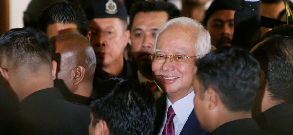 Former Malaysian PM Najib Razak charged with criminal breach of trust