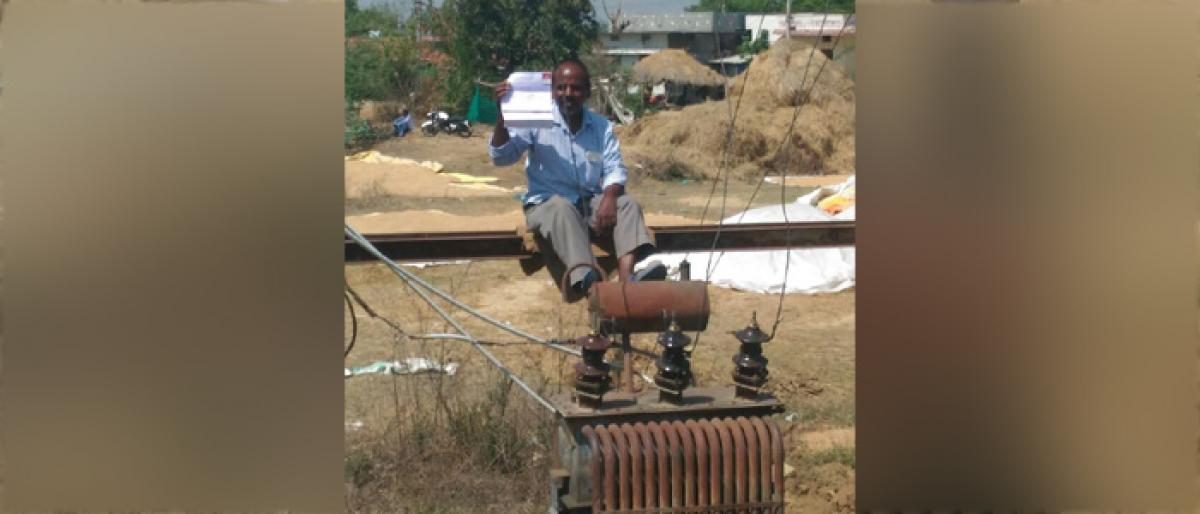 Man stages sit-in protest on transformer