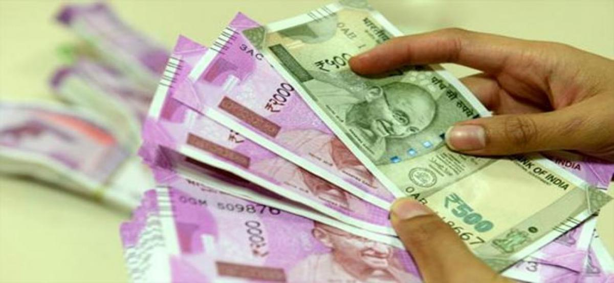Rupee gains 13 paise against US dollar in early trade