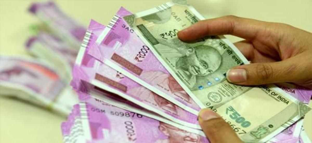 Rupee recovers from 16-month low, rises 15 paise against US dollar
