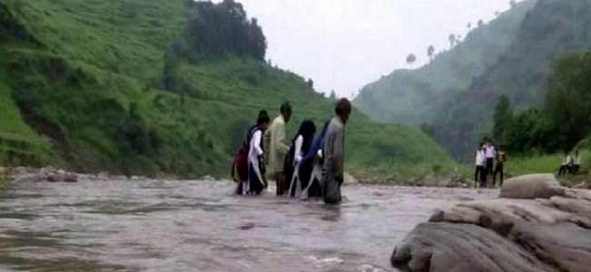 With no bridge, students dangerously cross river to reach school in Rajouri