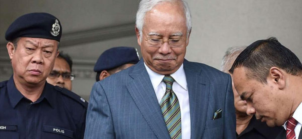 Malaysias ex-PM Razak pleads not guilty to money laundering charges