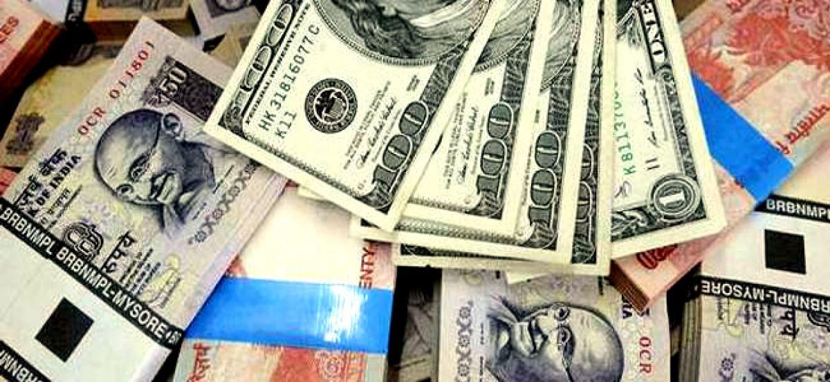 Rupee gains 10 paise to end at 65.11 against dollar