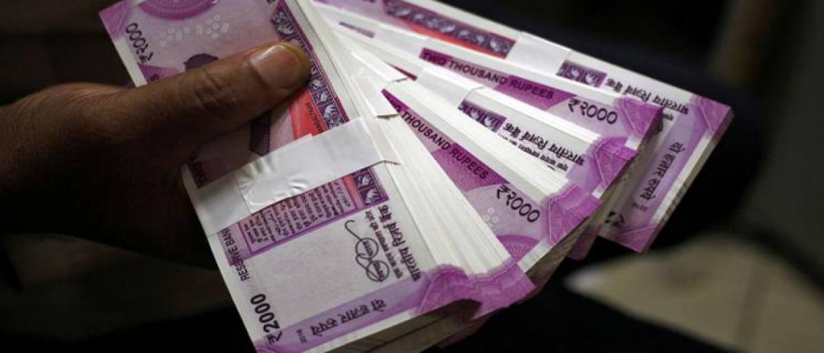 Rupee slumps 26 paise, sinks to 71-mark