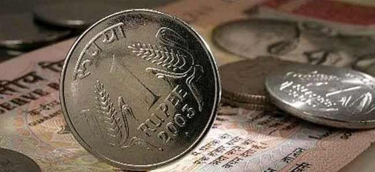 Rupee falls 14 paise against US dollar in opening trade