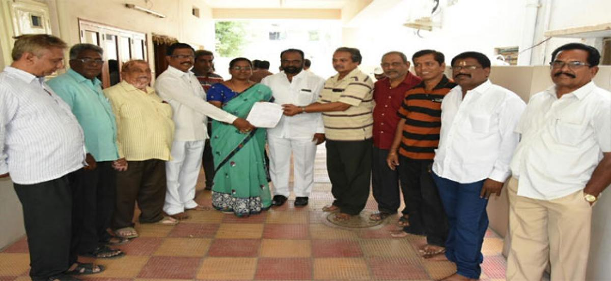 Locals pour outwoes before corporator Sirisha