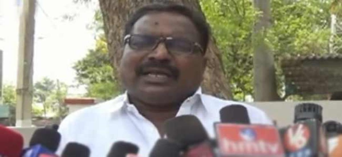 Corporator touches feet of motor vehicle inspector