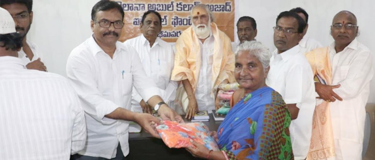 Scholarships, saris distributed in Bhimavaram